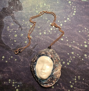 Serenity face necklace