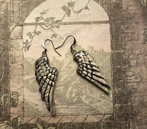 Wing earrings buff