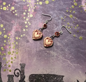 Mexican style heart earrings with flower glass bead and sterling silver ear wires.