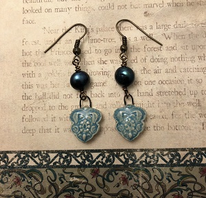 Aqua Indian pattern earrings with a blue fresh water pearl and antique brass ear wires.