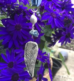Heavenly blue angel wing pendant
