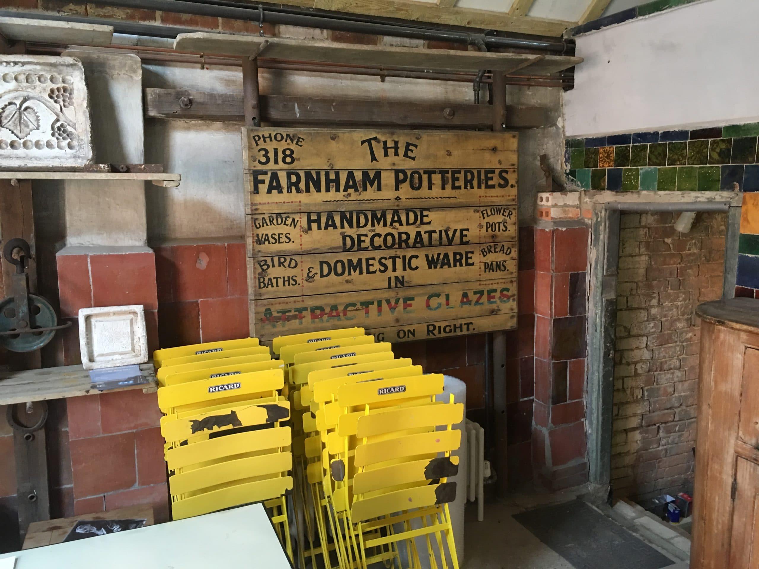 Yellow sign at Farnham pottery