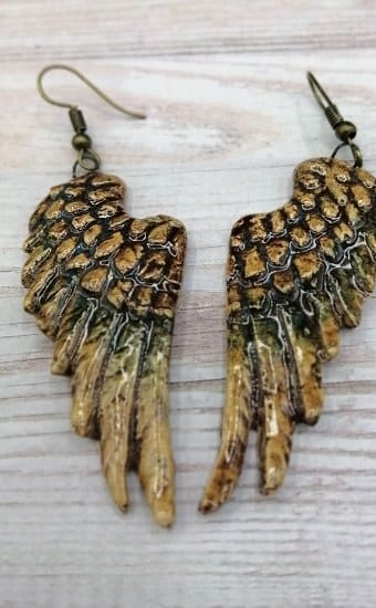 Brown angel wing ceramic earring