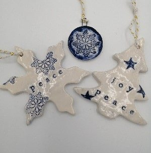 Blue snowfake and Christmas tree handmade ceramic decorations