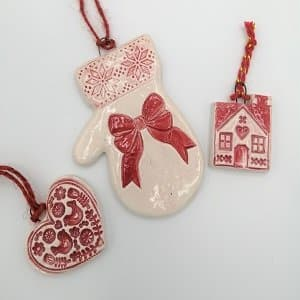 Red handmade ceramic Christmas decorations
