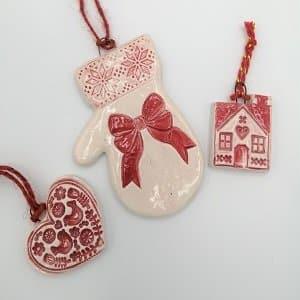 Red handmade ceramic Christmas decorations