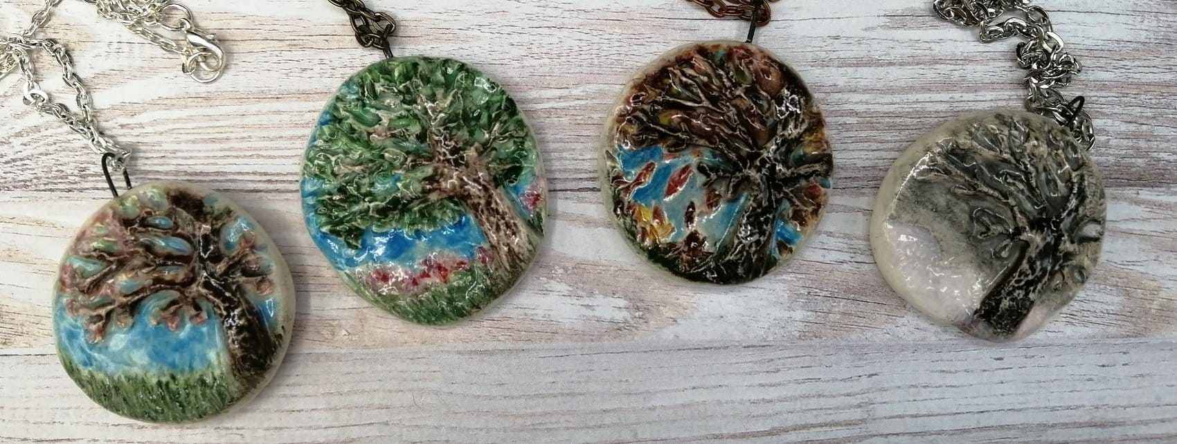 Group of four handmade ceramic tree of life pendants